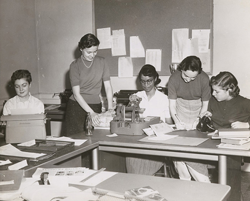 Women college students working on a newspaper