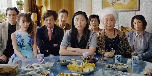 Asian-American men and women staring at camera