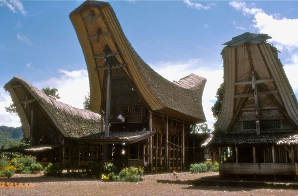 Wooden houses with very high peaked roof overhangs