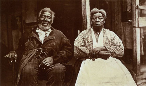 Seated elderly African American couple
