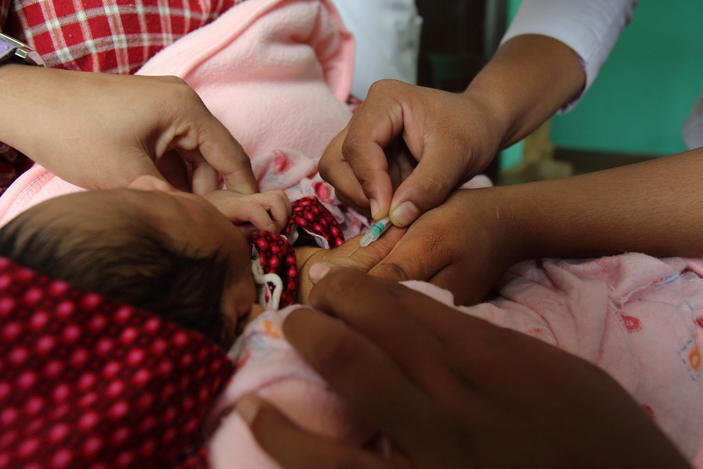 baby being vaccinated