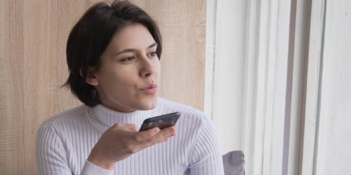Photo of woman speaking into a phone