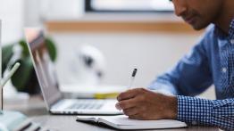 Photo of man typing