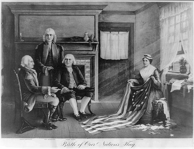 Print shows an interior scene with General George Washington seated on the left with Robert Morris, and standing, the Honorable George Ross, and with Betsy Ross seated on the right holding