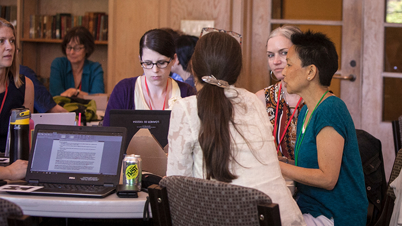 Faculty at Summer Teaching 2018 in the Knight Library Browsing Room