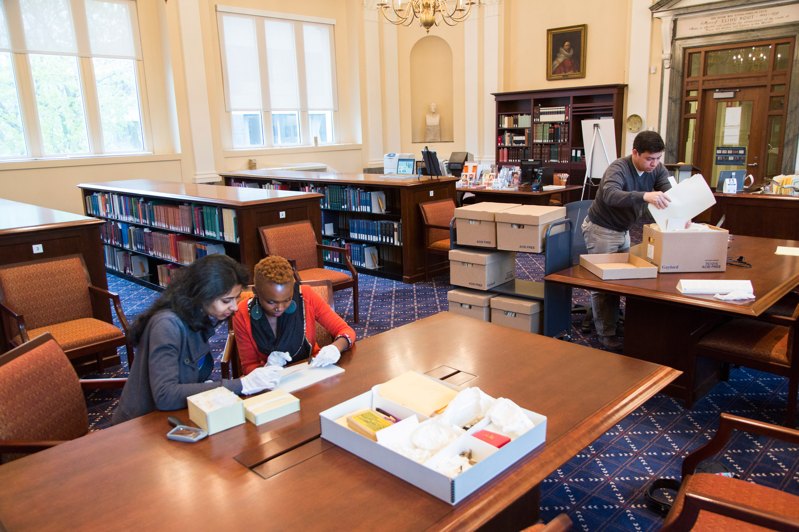 Photograph of researchers in the Historical & Special Collections reading room, the Root Room