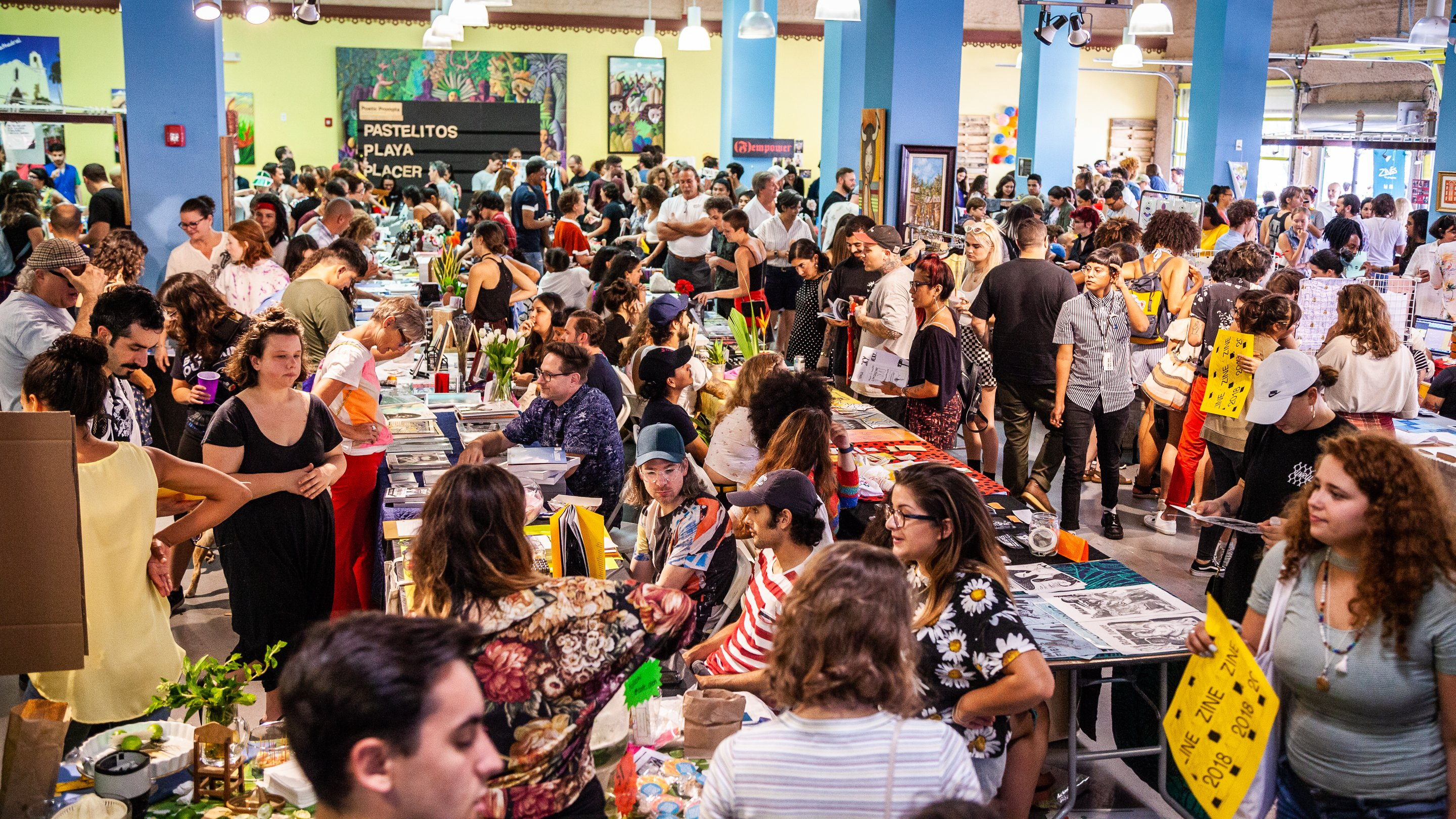 wide view of a miami zine fair co-hosted by Exile Books