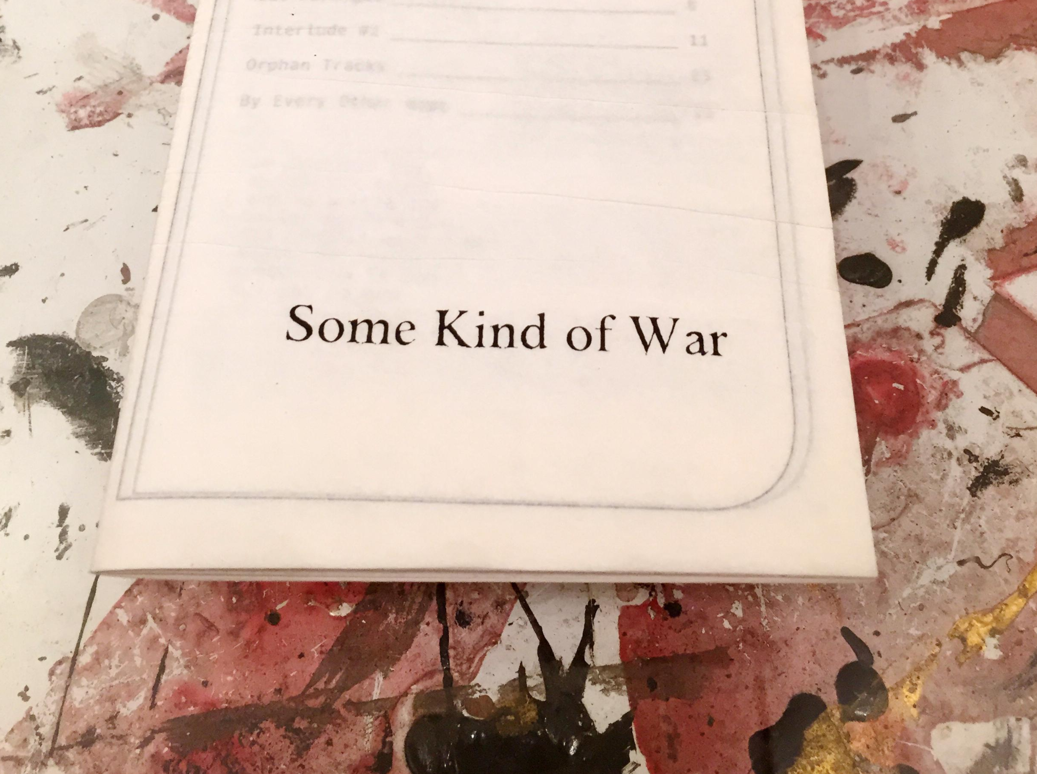Front cover of Some Kind of War (2013) Mestrich's artists' book of poetry and short stories printed on onion skin paper