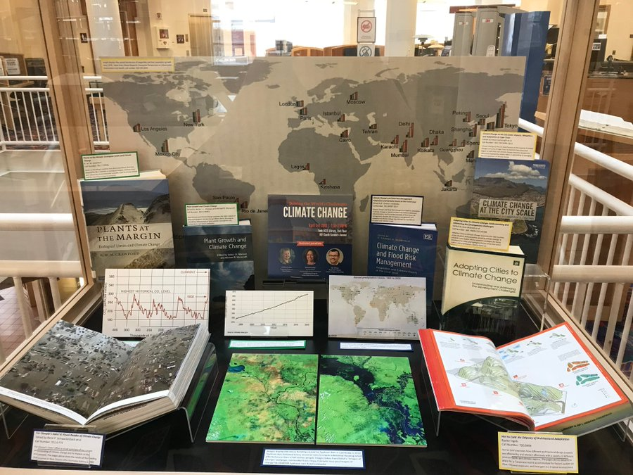 Color photograph of a book display on climate change in Funk ACES Library