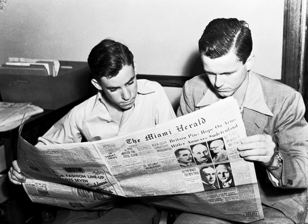 """Two Students Reading the Miami Herald"""