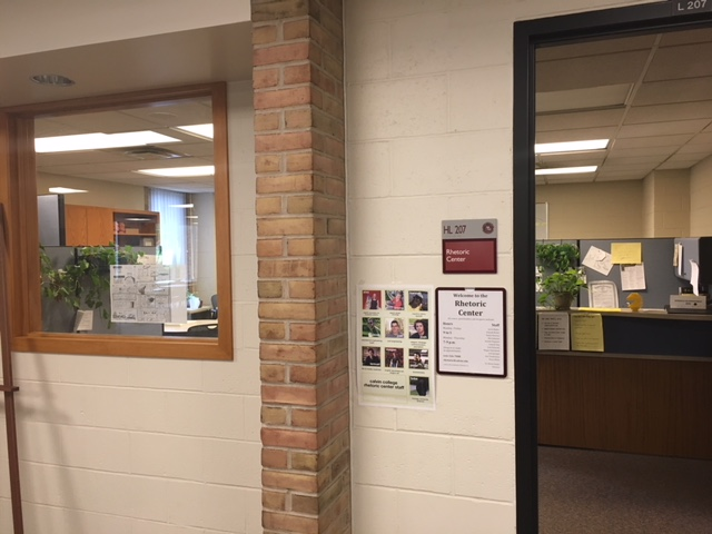 View of the entrance to the Calvin Rhetoric Center office, door and window open into room with consultation tables