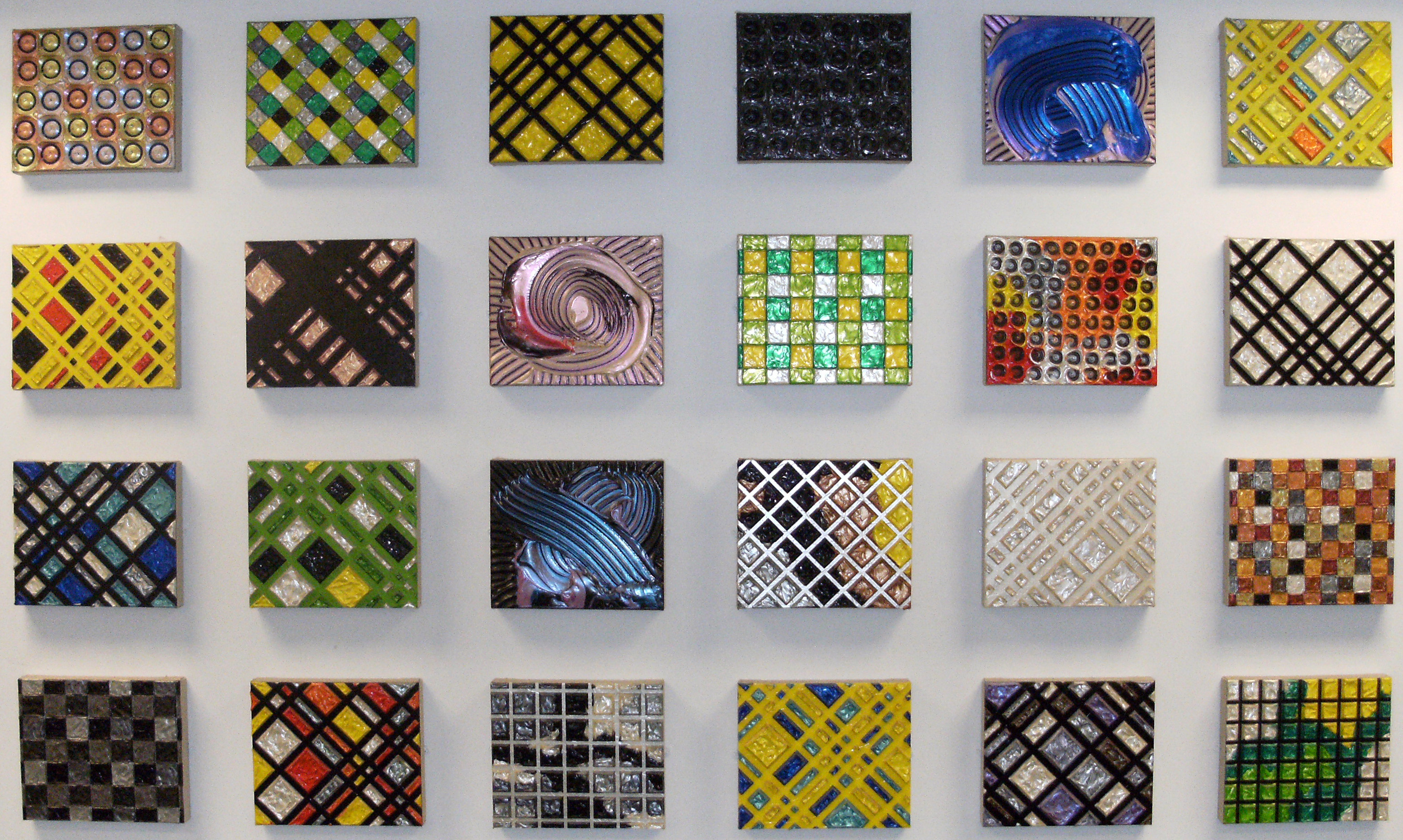 Twenty-four untitled works of art organized in a grid, 2005 - 2006, by Alberto Contreras. Gift from the artist. Located at Alexander Library.