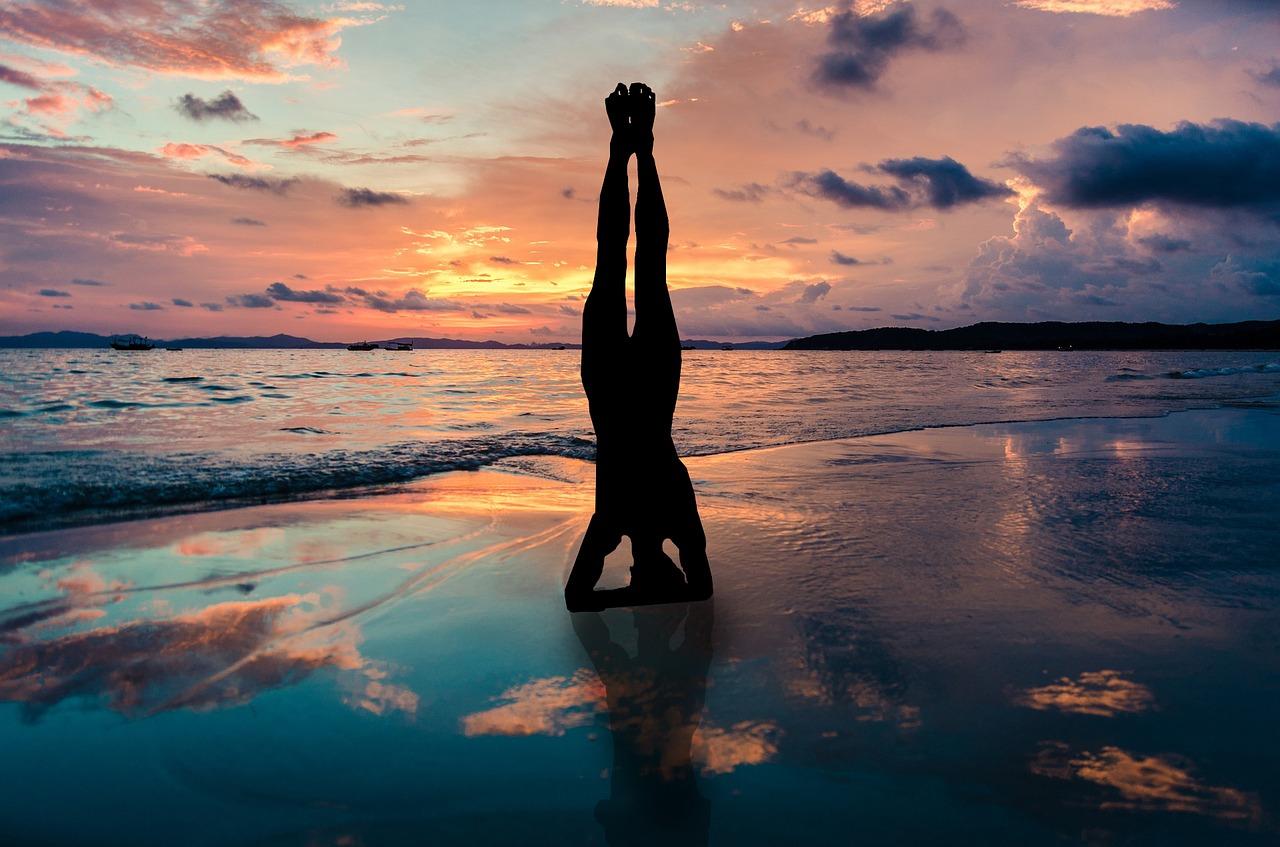athlete handstand on beach