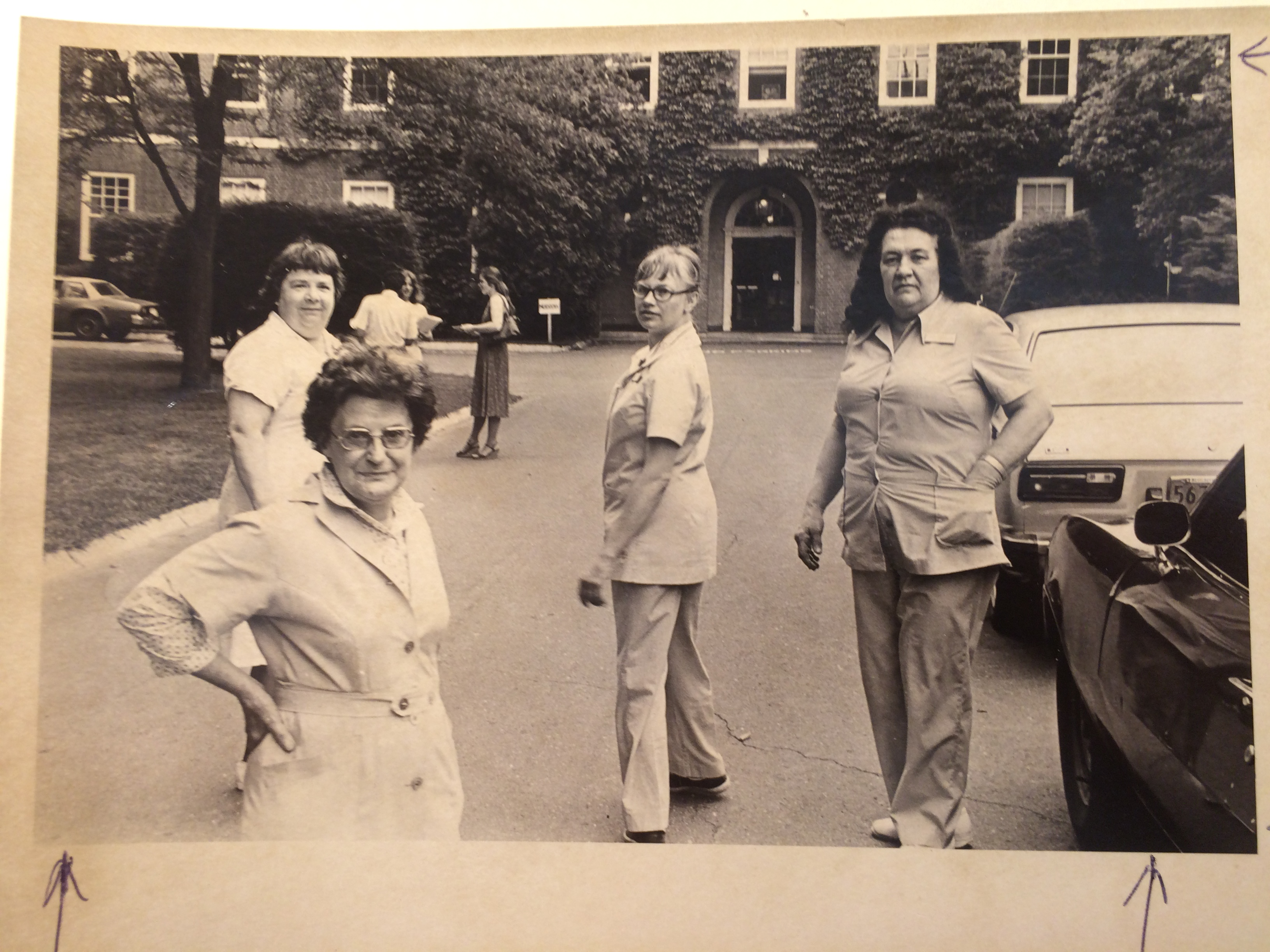 Photo of women in housekeeping uniform, going to work at Smith College.