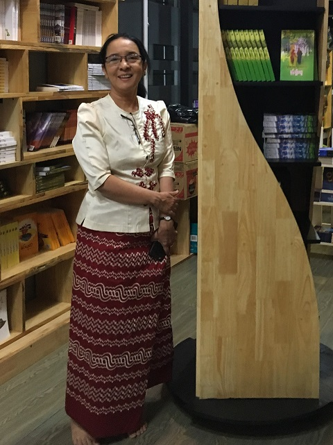 Hlaing Hliang Gyi, Director of the Universities Central Library assists with book purchases in Yangon
