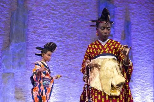 Two models wear kimonos designed with West African ankara fabrics.