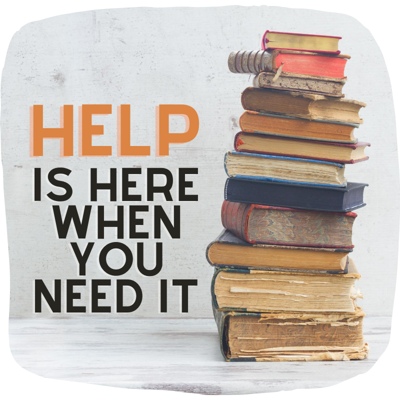 """""""Help is here when you need it"""" quote next to stack of old books."""