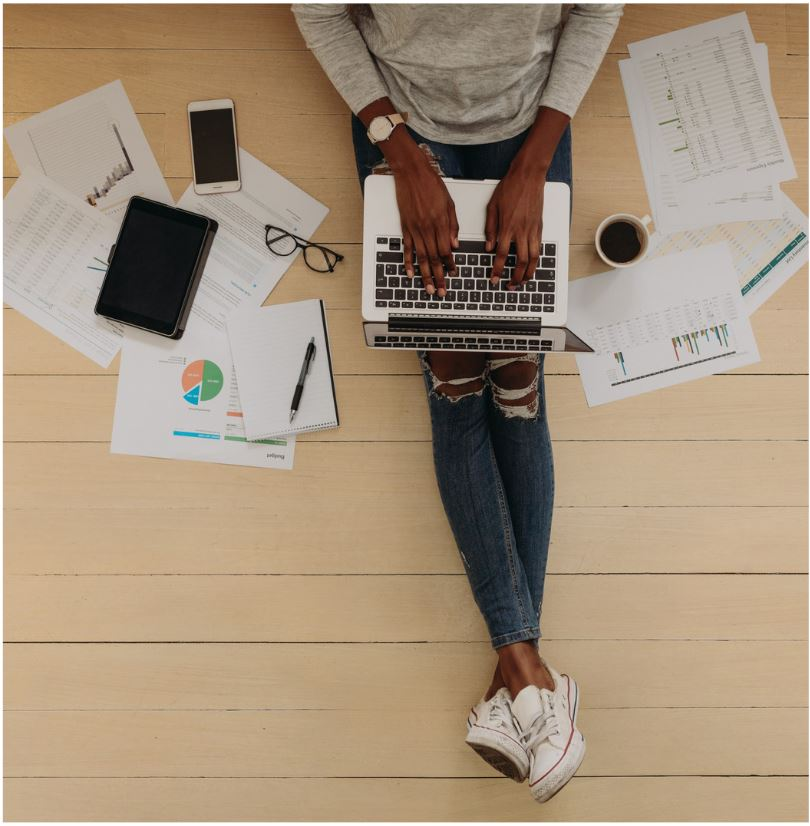 Stock photo of student surrounded by homework