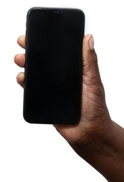 Black hand holding phone