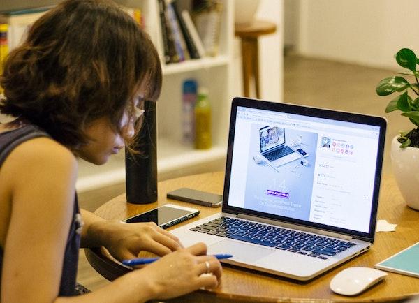 Woman reading on laptop