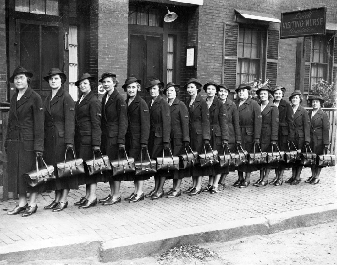 Members of the nursing guild lined up in a row