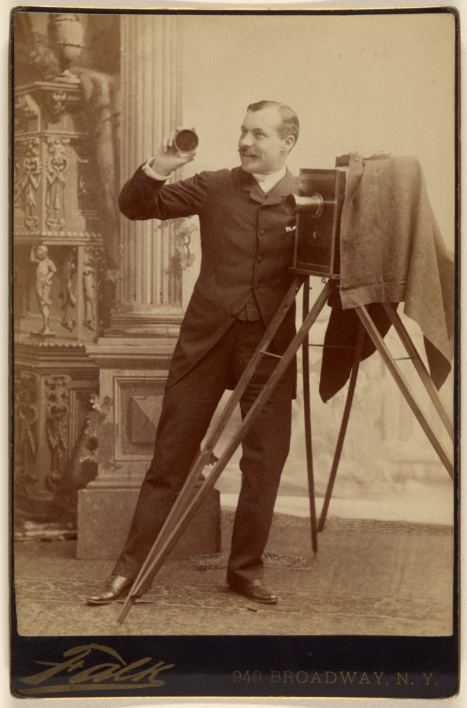 An Actor Posing with a Large-Format Camera