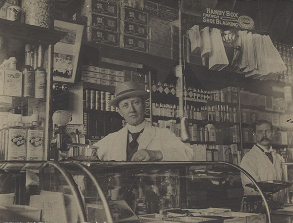 Félix Gatineau standing behind the counter in his shop.