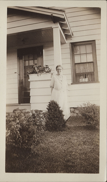 Elise Rocheleau standing outside a home, near a porch.