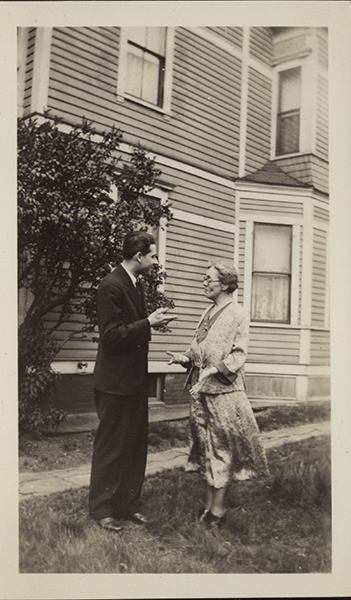 Elise Rocheleau and an unidentified man having a conversation outdoors.