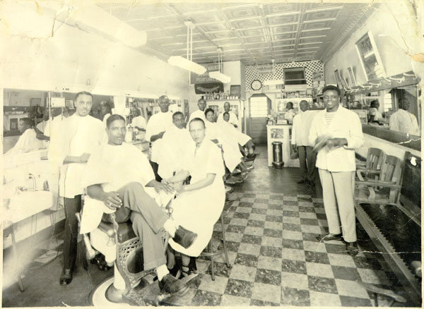 De Luxe Barber Shop employees and patrons, 1948
