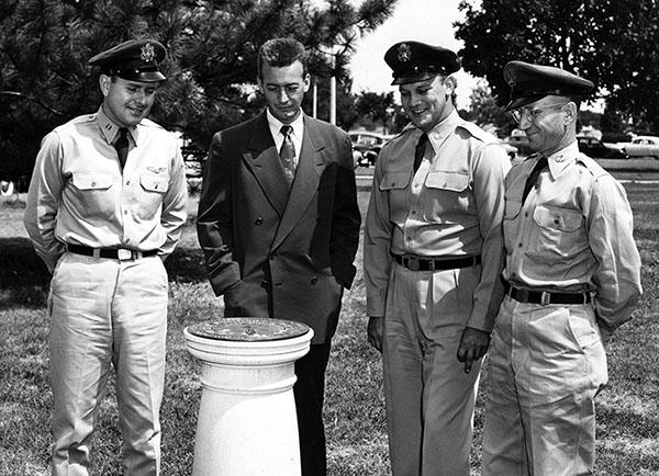 WSU President Harry Corbin, Lt. Col. Herbert Hartman, and ROTC captains Robert Goss and Joseph Cunningham around sundial