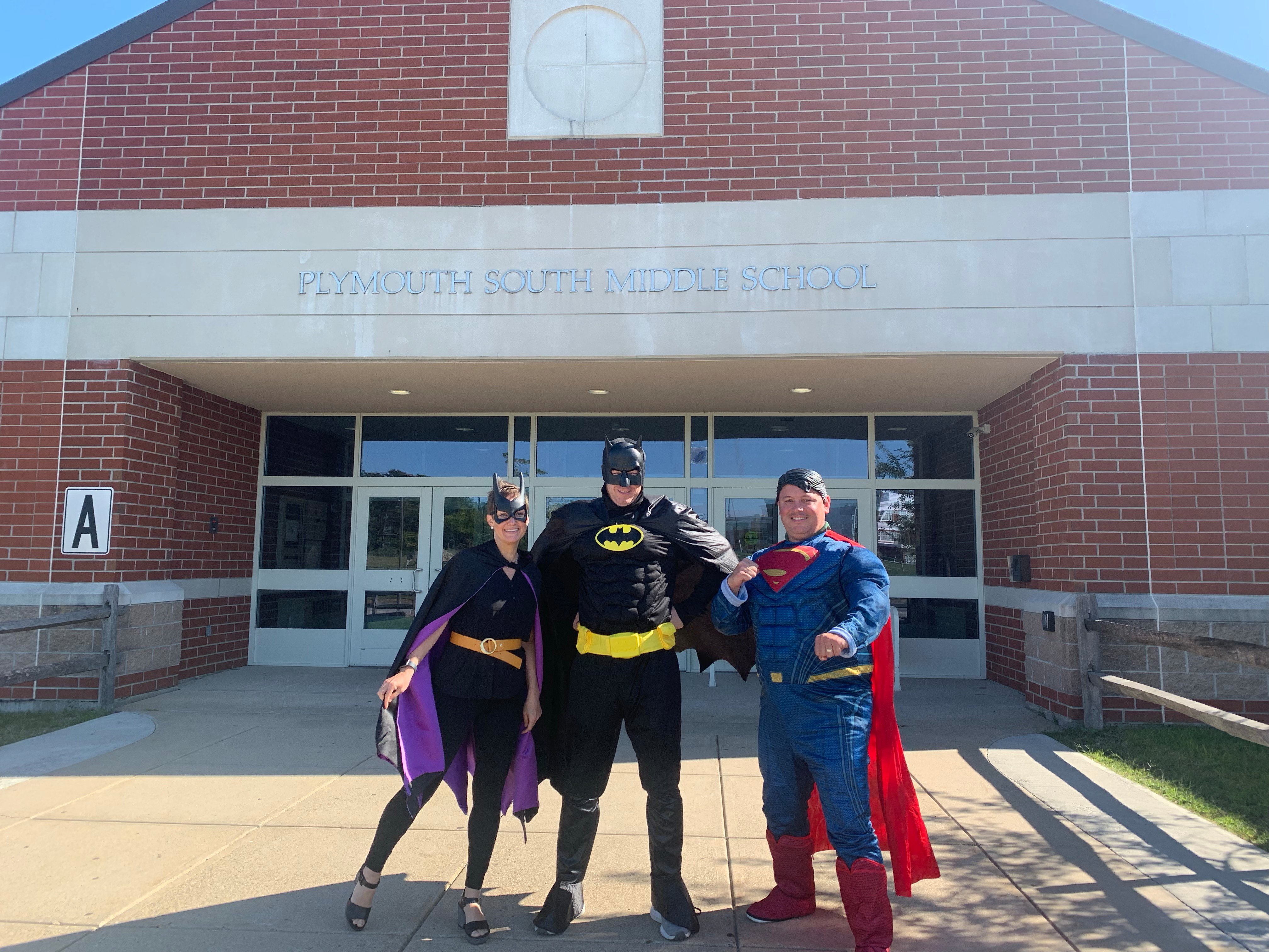 School administrators dressed as superheroes to support the book fair.