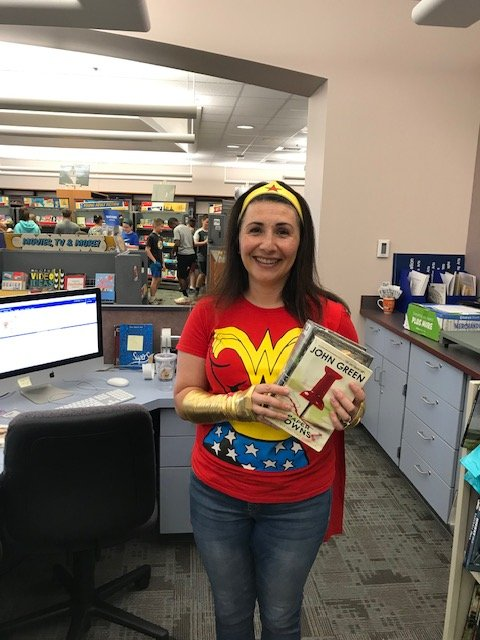 Librarian dressed like Wonder Woman to support book fair