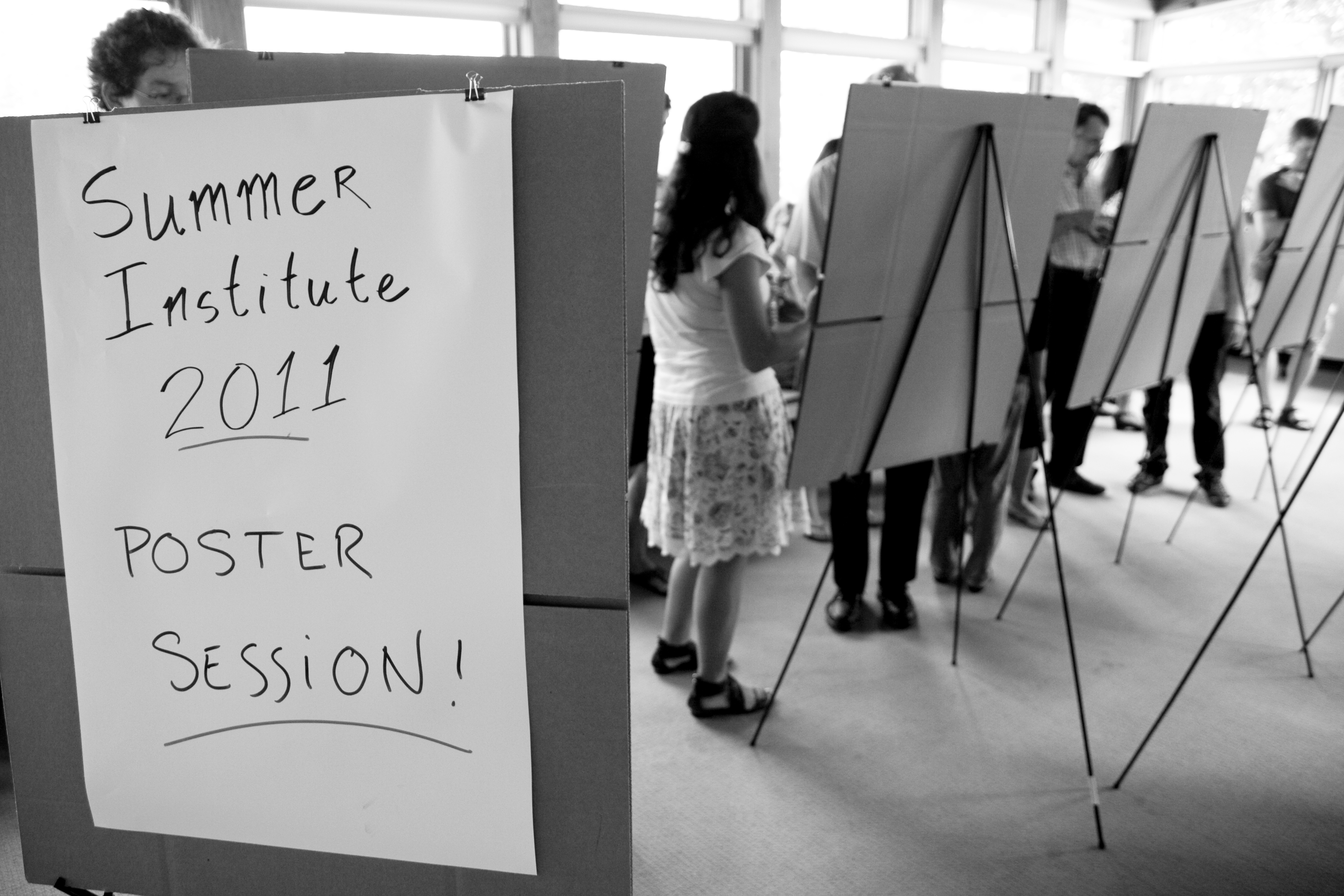 Picture of a poster session with posters on easels