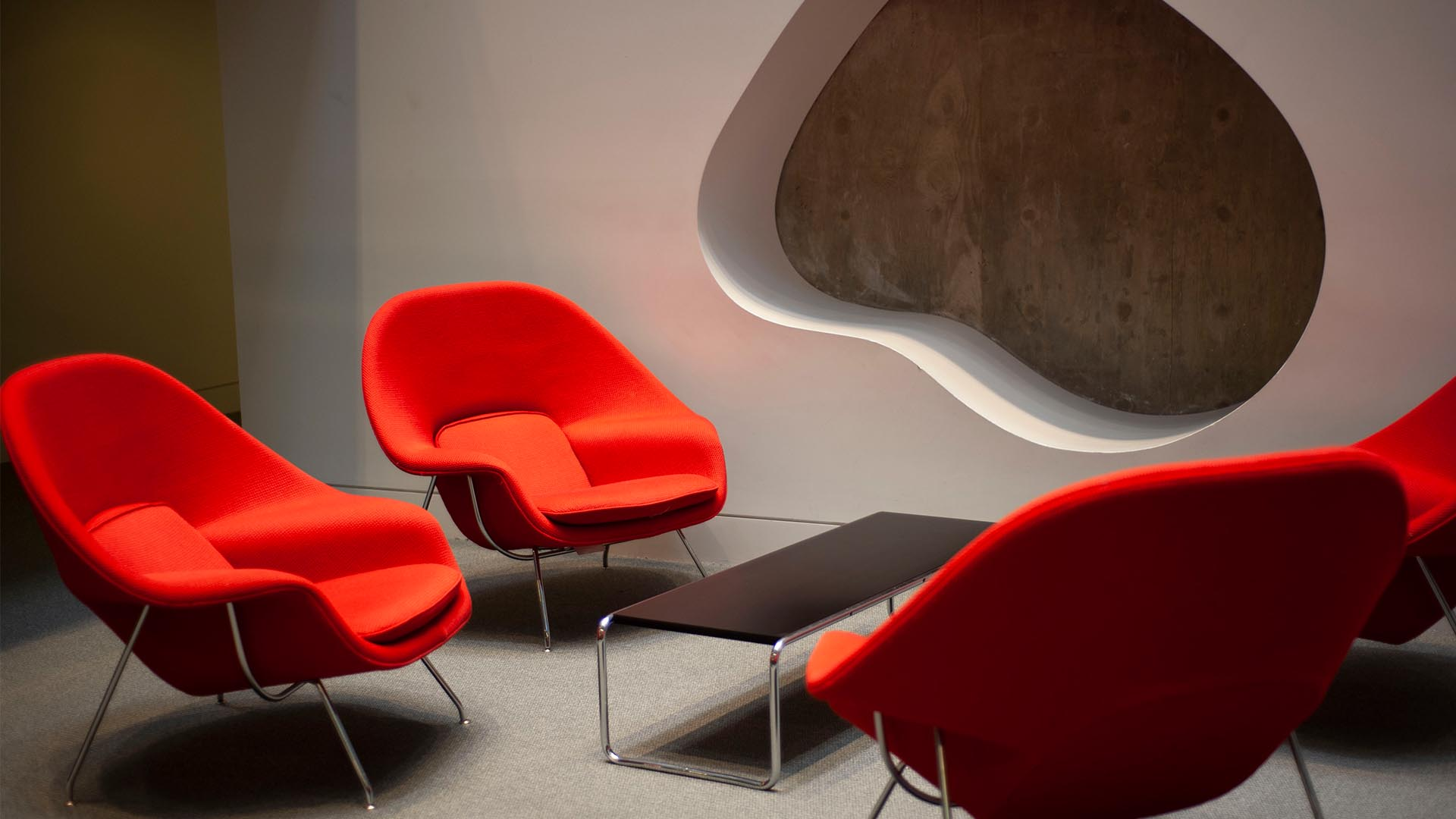 A photo of the iconic orange chairs at the Haas Arts Library.