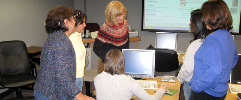 Librarian conducting training for clinic staff and students in computer classroom