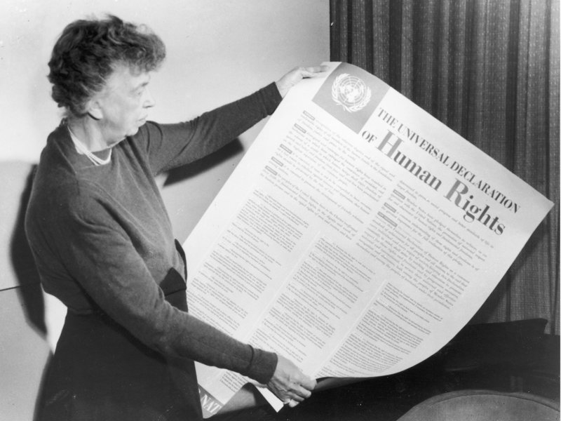 Eleanor Roosevelt holds up a copy of The Universal Declaration of Human Rights, adopted by the United Nations in December 1948. Fotosearch/Getty Images