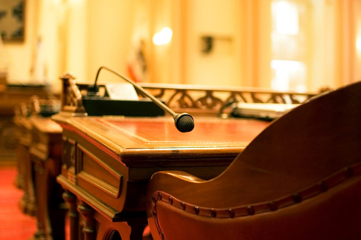 photo of desk and microphone in the state legislature chamber