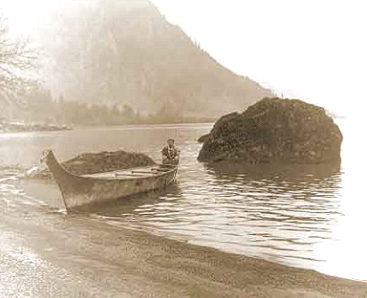 Edward Curtis image of a Cascade Indian woman, Kalliah, in a Chinookan Style Canoe on the Columbia River