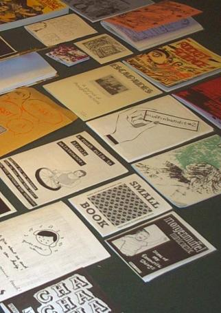 various zines displayed on a table