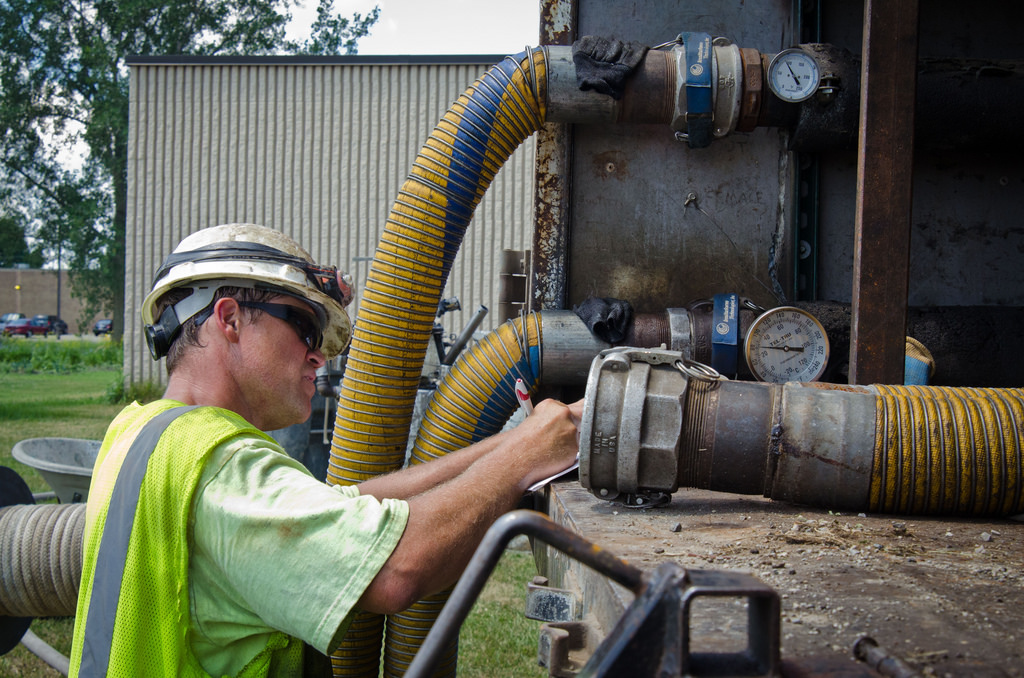 Engineer records water pressure, temperature and other readings during a curing process for the Buena Vista Township Phase II Sewer Project, in Michigan,
