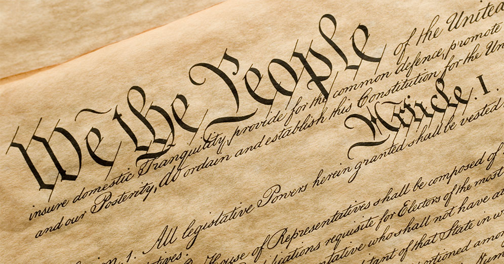 Photograph of the first page of the U.S. Constitution.