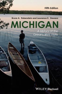 Cover image of man in front of three canoes that are beached at the lake shore.