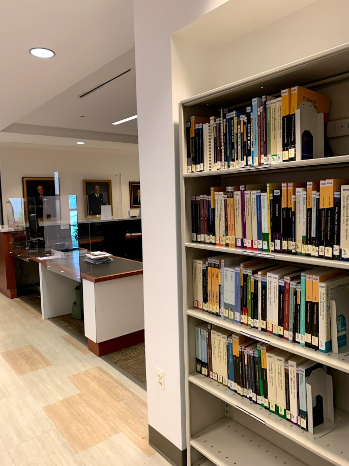 image of study aids bookcase located on first floor near circulation desk