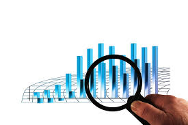 Magnifying glass over columns in a statistical chart