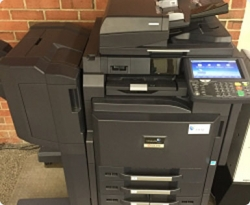 Photo of a large, black campus photocopy machine.