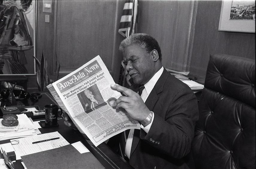 HW reading the newspaper