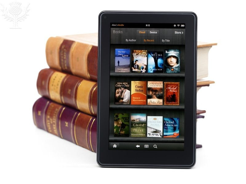 Amazon Kindle Fire tablet computer e-book reader leaning against a pile of hardcover books. Photo. Britannica ImageQuest, Encyclopædia Britannica, 25 May 2016. quest.eb.com/search/167_4052406/1/167_4052406/cite. Accessed 22 Apr 2020.