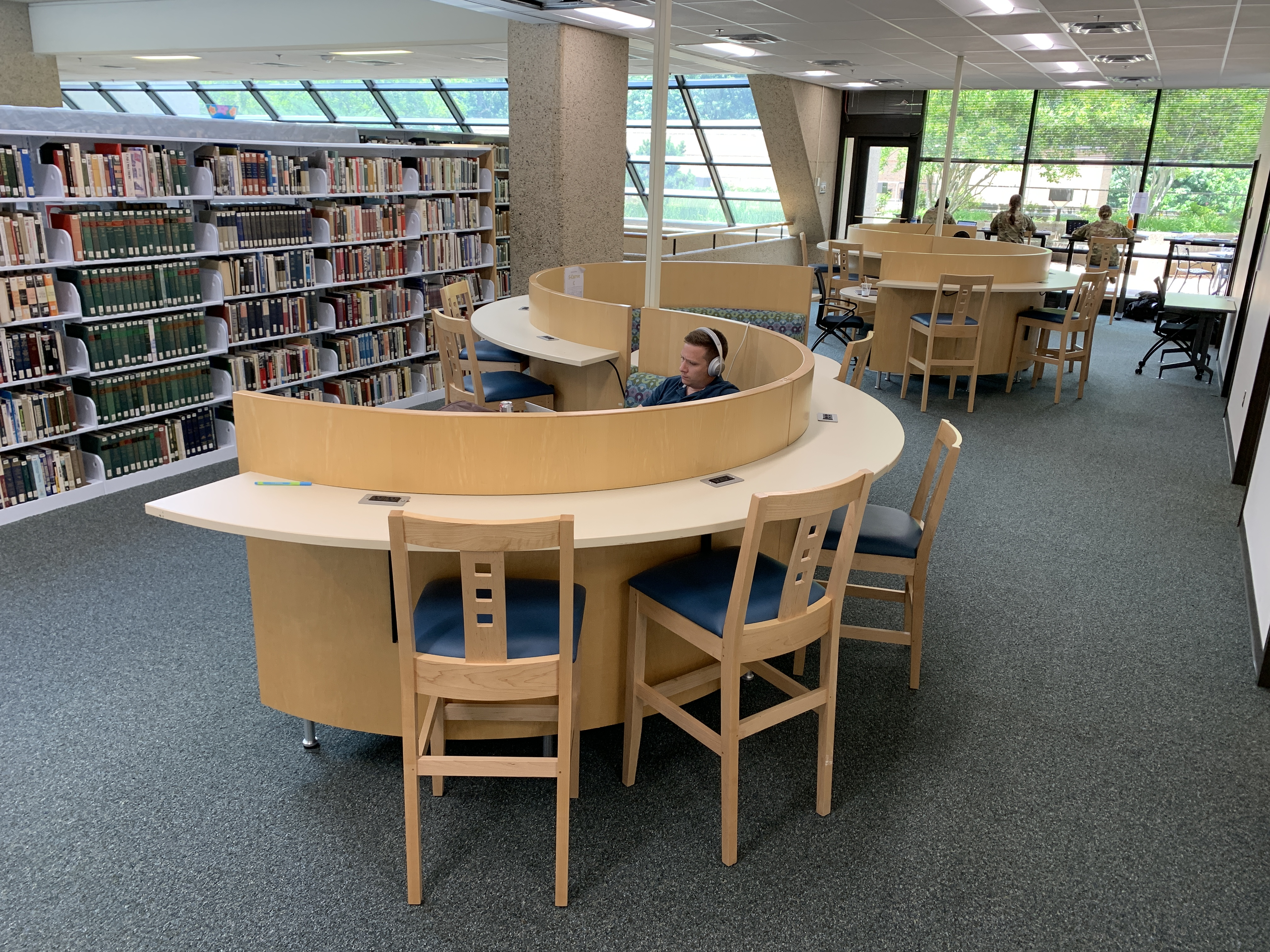 A picture of a couch and desk combination for group and individual study on the second floor.