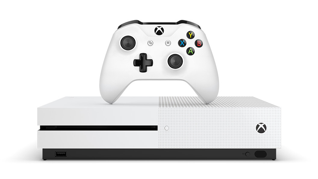 White Xbox One S console with controller in front of a white background